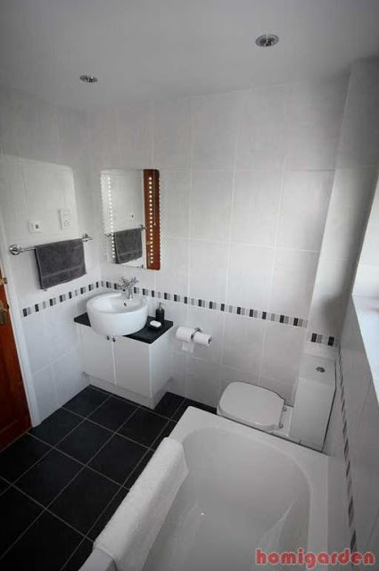Black and white flooring in the bathroom looks really pretty and designed