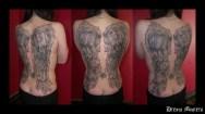 Svetlyo , Custom black and grey wings back peace tattoo