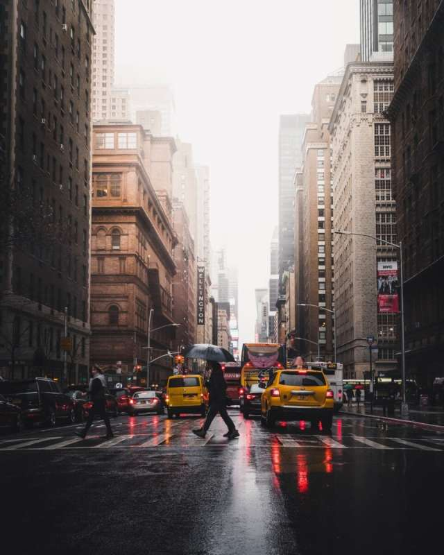 nyc rainystreet with yellow taxis and pedestrian