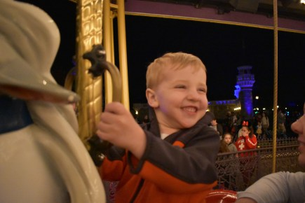 This kid lives for the carousel.