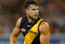 Brett Deledio of the Tigers in action during the 2014 AFL round 02 match between the Richmond Tigers and the Carlton Blues at the MCG, Melbourne on March 27, 2014. (Photo: Lachlan Cunningham/AFL Media)