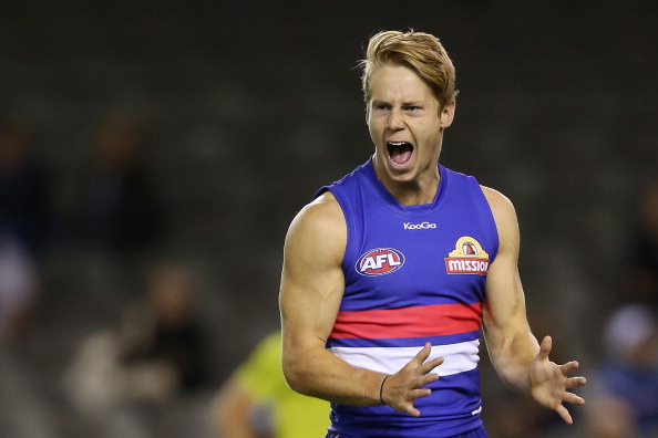 MELBOURNE, AUSTRALIA - FEBRUARY 26: Lachie Hunter of the Bulldogs reacts after missing a goal during the round three AFL NAB Challenge match between the Western Bulldogs and the Fremantle Dockers at Etihad Stadium on February 26, 2014 in Melbourne, Australia. (Photo by Michael Dodge/Getty Images)