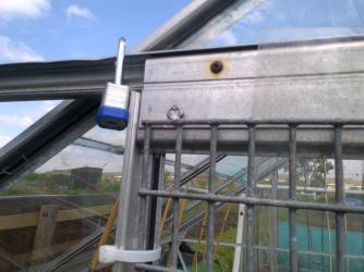 A hole was drilled into the slide frame, so the door will not slide open until the lock is removed.