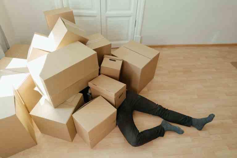 brown cardboard boxes on brown wooden floor