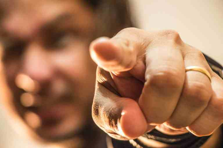 photo of man pointing his finger