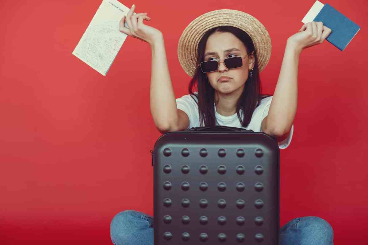 anxious young lady with tickets and passport on red background