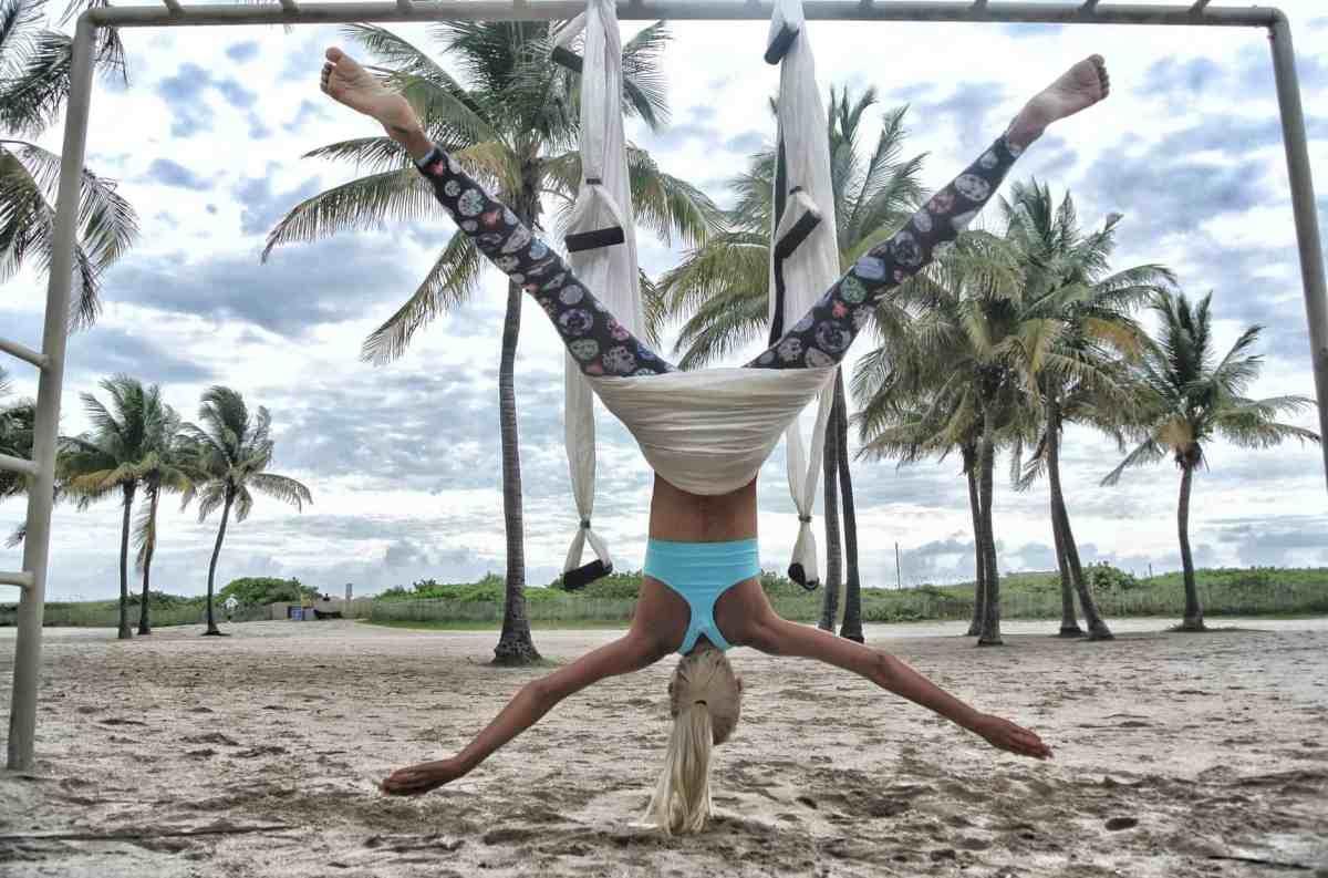 woman doing anti gravity yoga