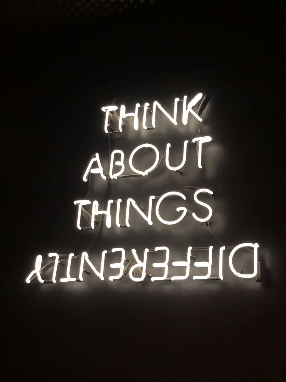 neon signage Think about things differently and taking responsibility