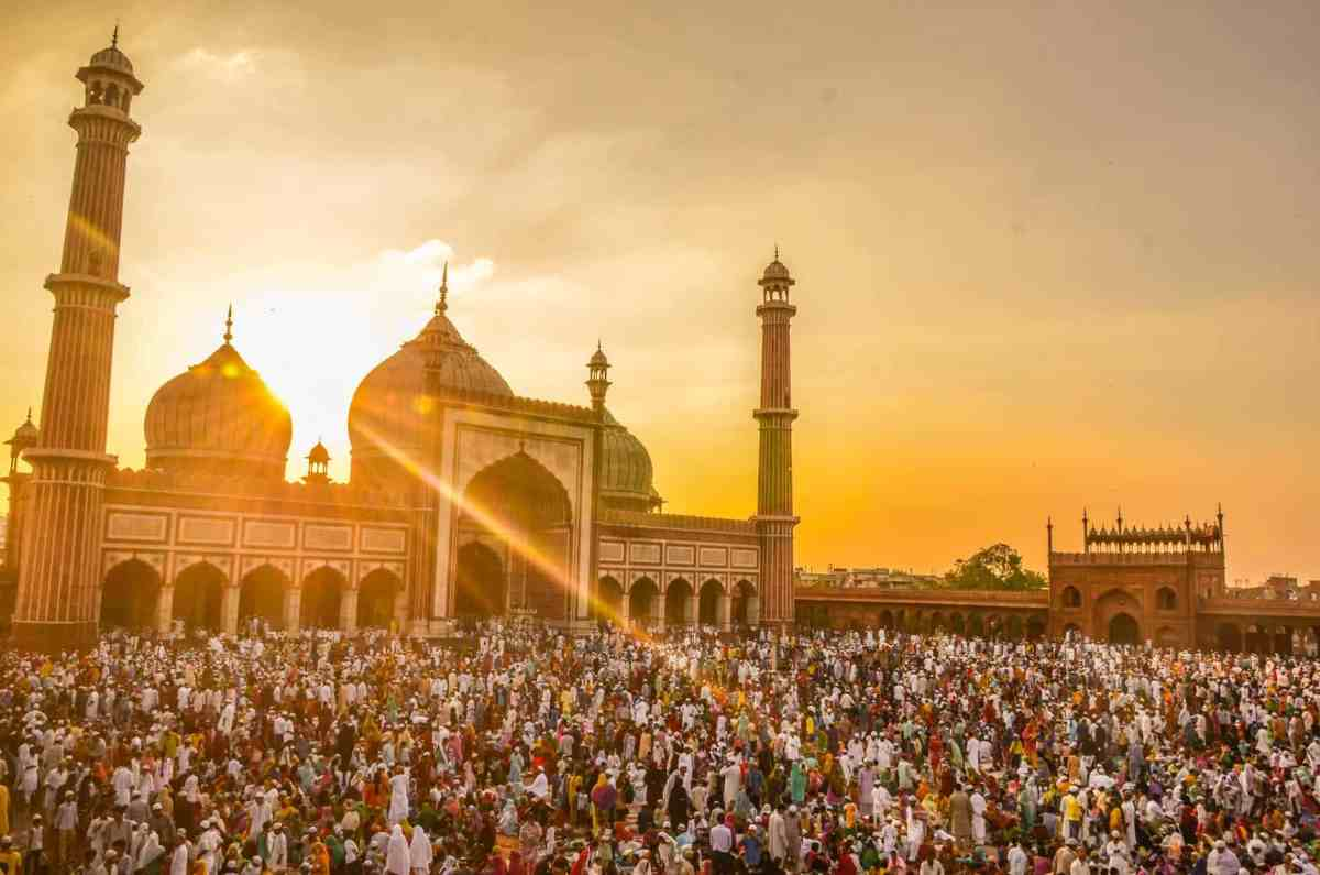 people in front of mosque during golden hour