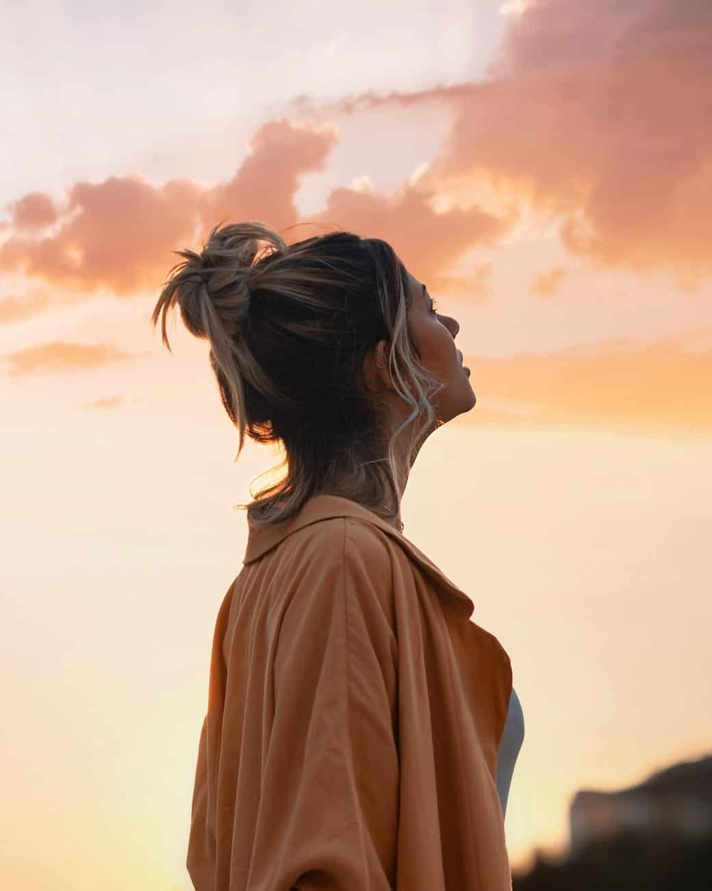 woman looking towards the sky