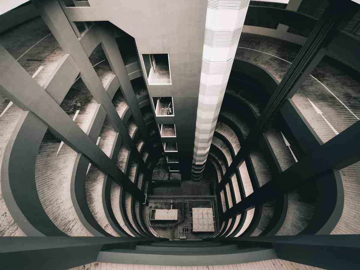 futuristic concrete building of multilevel parking