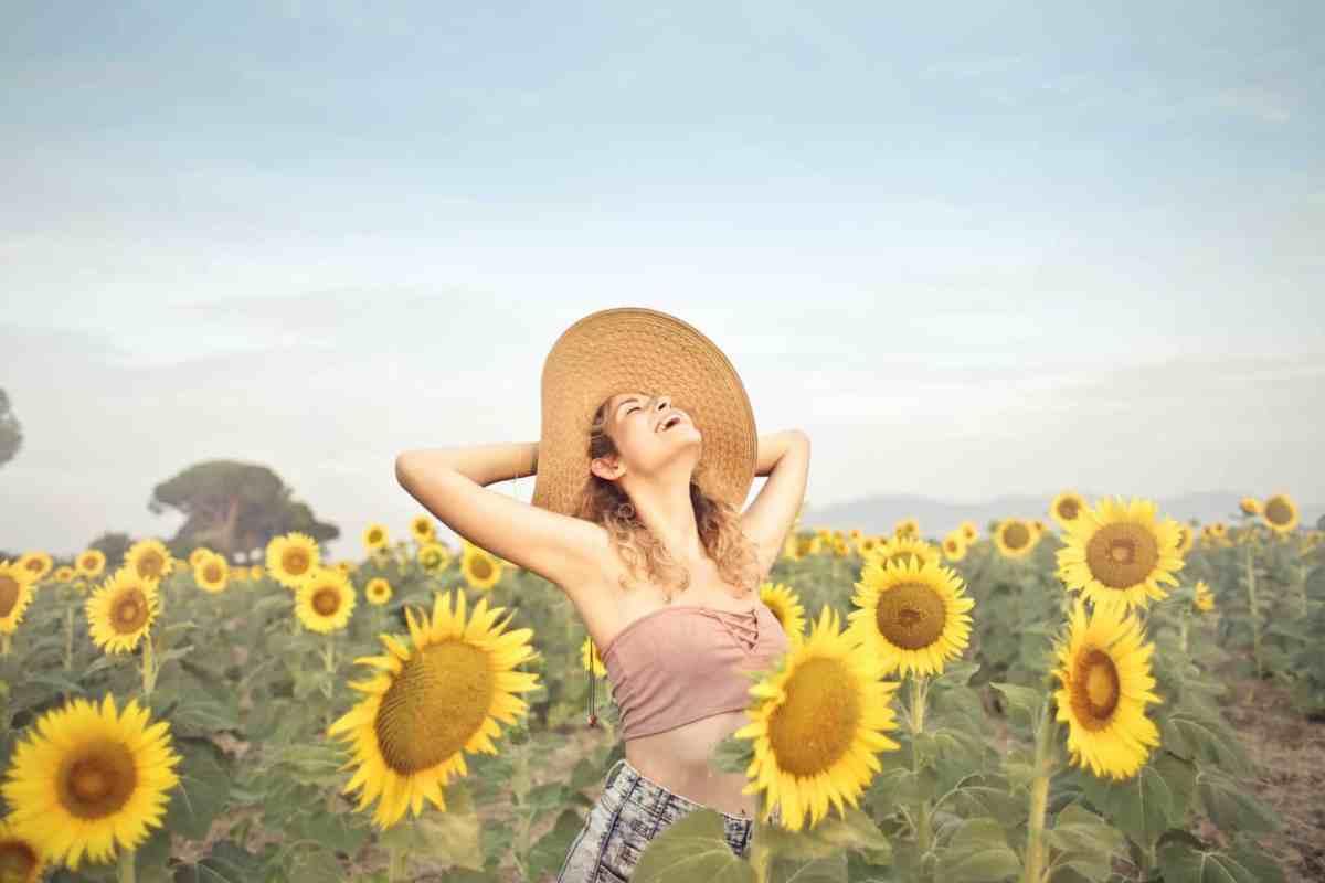 woman standing on sunflower field