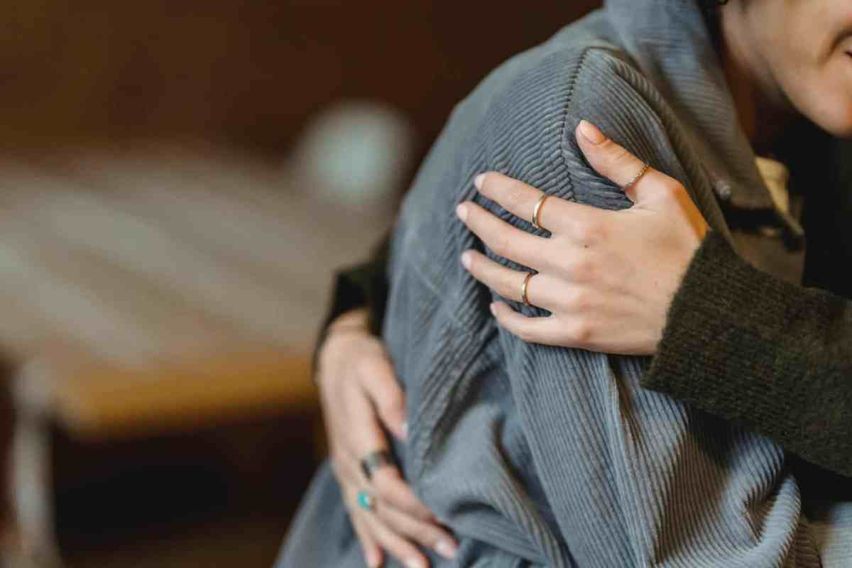 woman comforting desperate girlfriend and embracing gently - the right mindset can lead to manifestation