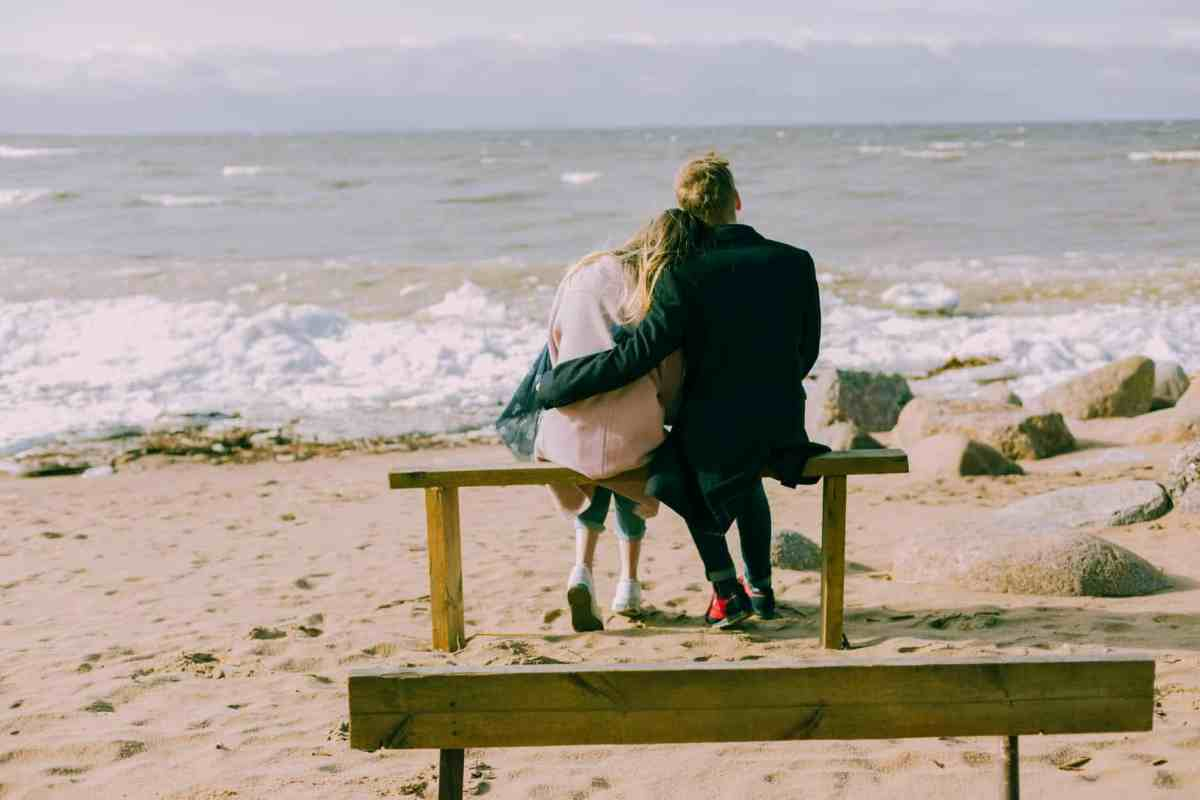 man and woman hugging and sitting on a bench - let hope be your guide