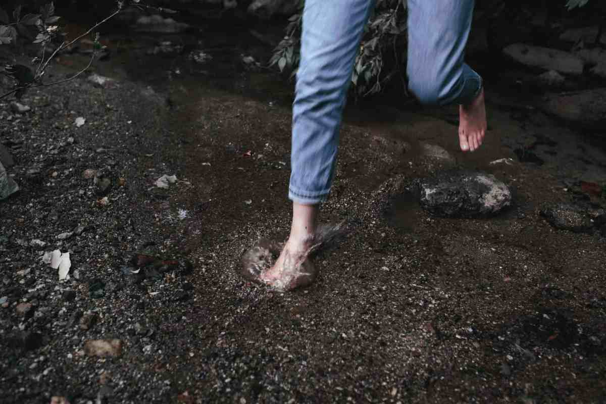 person in blue denim jeans standing on brown soil - struggle to success