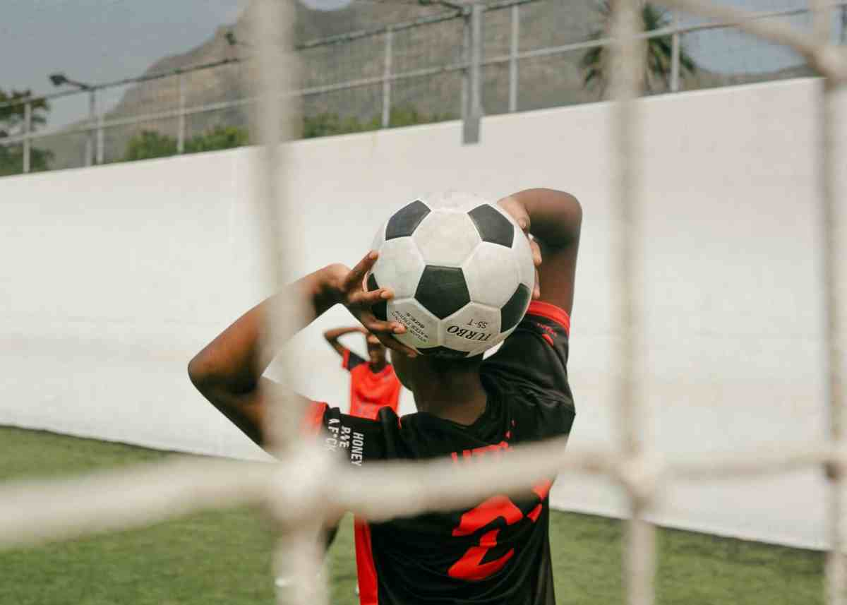 a player holding a soccer ball - we're all winners