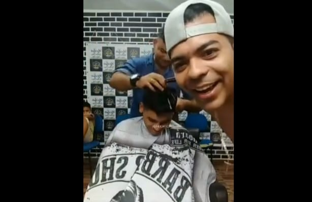 Dude Got Clapped Up While Getting His Hair Cut