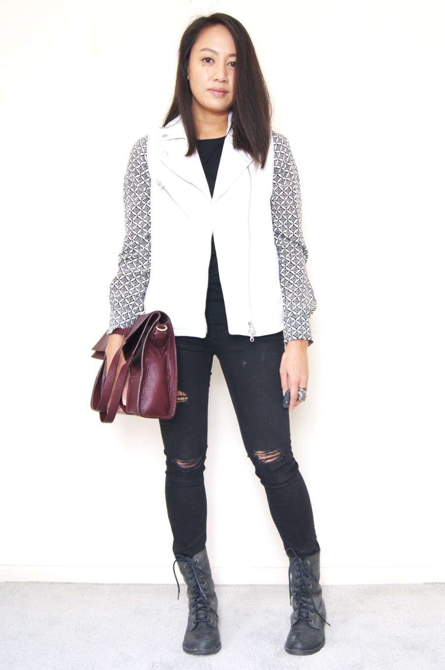 DRESSED ACCORDINGLY // White leather vest + combat boots + ripped denim