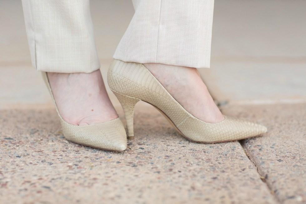 Snakeskin pumps complement this khaki suit by Antonio Melani.