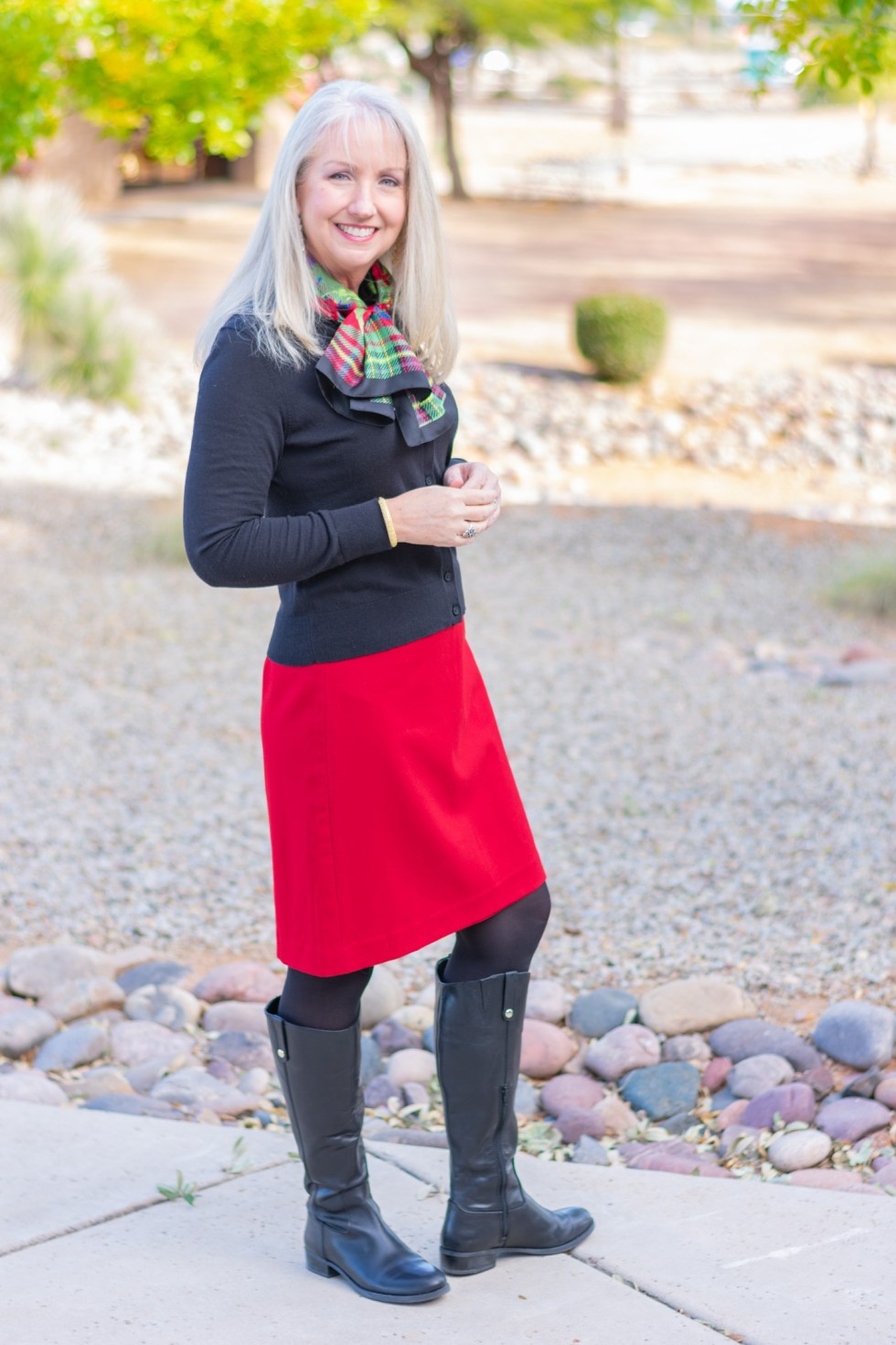 black riding boots with a wool skirt