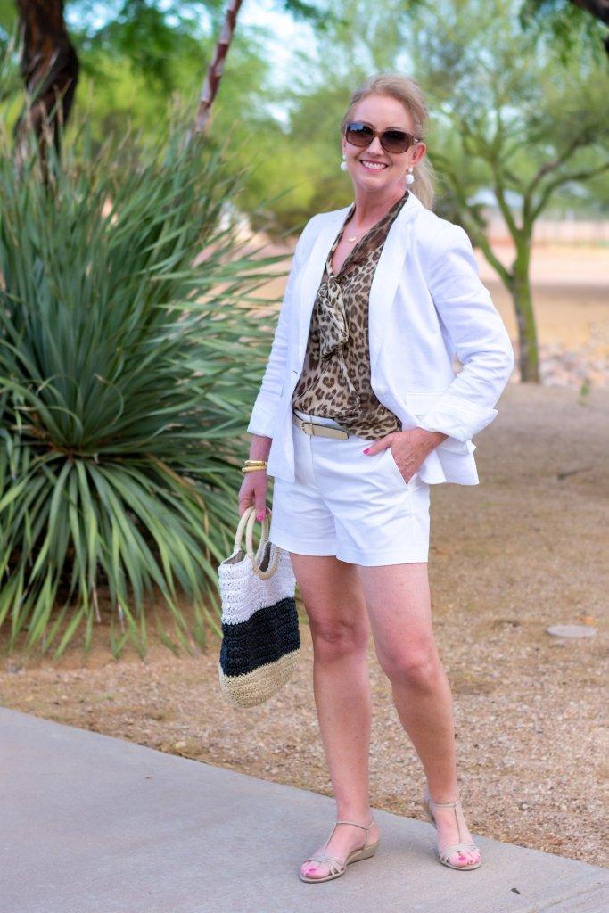 white blazer with animal print blouse