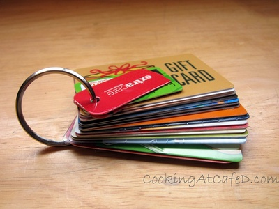 store gift cards by punch-holing and putting on ring