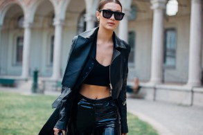 Top model Bella Hadid wears all black chunky sunglasses, a leather jacket, bra top, and pants after the Alberta Ferretti show during Milan Fashion Week Spring/Summer 2017 on September 21, 2016 in Milan, Italy.