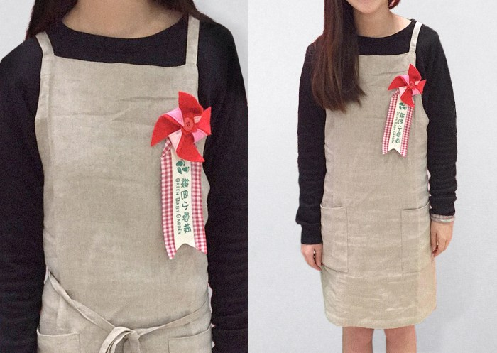 Green Baby Garden CNY edition uniform apron with an identity brooch