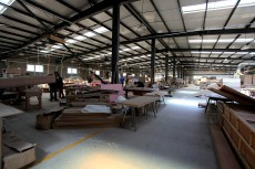 whole wood work cabin, machinery, workers, cutting wood pieces, raw material   Leading Retail Renovation Brand – HTHY Group :: Photography of Factory for brand book