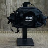 black raw steel height adjustable bag holder, small waist bag in use | British Fashion Retail Brand – Magnum London :: Visual Merchandising