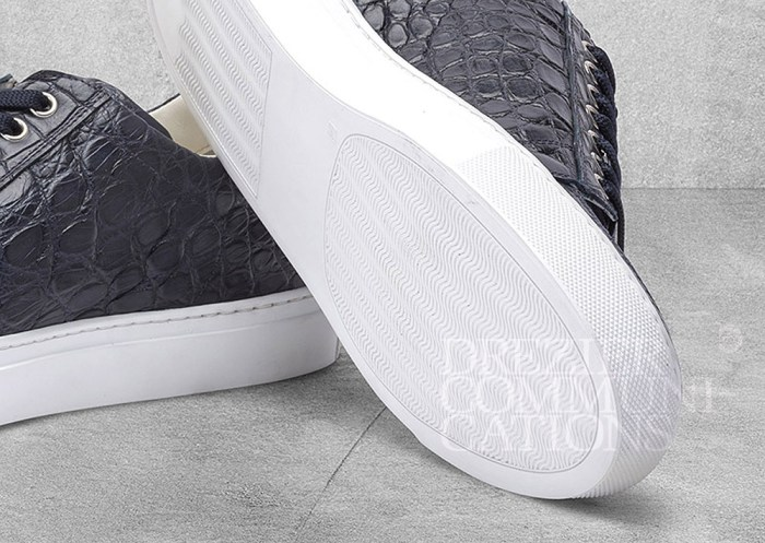 men's causal shoes charcoal bottom white table top, accessories photography on cement background styling art direction retouched colour management | Garment Merchandising Company in Hong Kong : : Styling and Imaging of Apparel Made in and Imported from Italy Reselling through e-Commerce