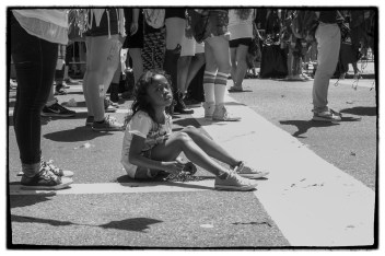 This young girl had dropped her beads in the middle of the parade and from the looks of it she had had enough!
