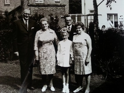 My First Communion, together with my grandparents. In the background (on the left) you can see the house where my parents still live.