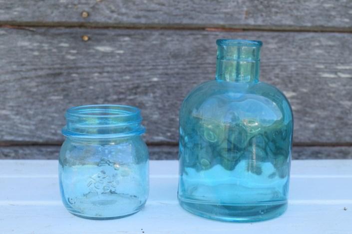 Aqua blue glass bottles and jars