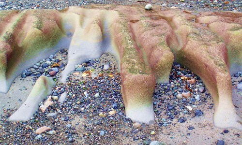 Nothing is forever! Sandstone and granite rocks, work on each other within the force of water