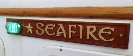 A Christmas present for the ship. New teak trailboards, carved in relief sport new led running lights.