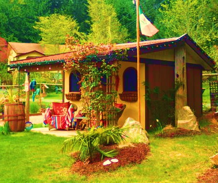 """A backyard cabin on Vancouver Island. Someone's fascination with Mexico is clear. Note the guitar and the piñata on the porch. """"Hola senorita! Donde mi margarita?"""