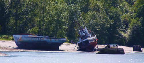 Careening on the beach for bottom maintenance among the wrecks of Dogpatch in Ladysmith Harbour
