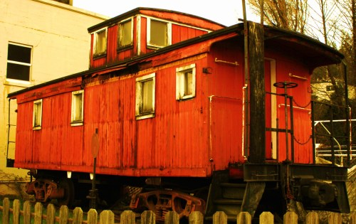 Downtown Train Avery old wooden railway caboose on mains street in Astoria
