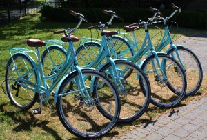 A lineup of rental/tour bikes. A great way for visitors to see the city, ...and no-one seems worried about their safety