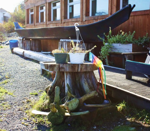 Flotsam, whale bones and a dug-out canoe. In front on the Koeye Café on the beach in beautiful downtown Bella Bella.