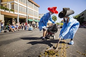 """30 JUNE 2012 - PRESCOTT, AZ: """"Pooper Scoopers"""" pick up horse dung during the Prescott Frontier Days Rodeo Parade. The pooper scoopers are among the most popular people in any parade that features lots of horses, and lots of horses march in the Prescott parade. The parade is marking its 125th year. It is one of the largest 4th of July Parades in Arizona. Prescott, about 100 miles north of Phoenix, was the first territorial capital of Arizona. PHOTO BY JACK KURTZ"""