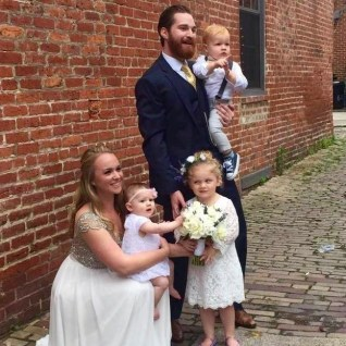 The happy couple with their ring bearer and flower girls