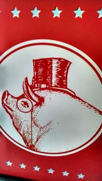 The Polite Pig logo. He looks pretty classy.