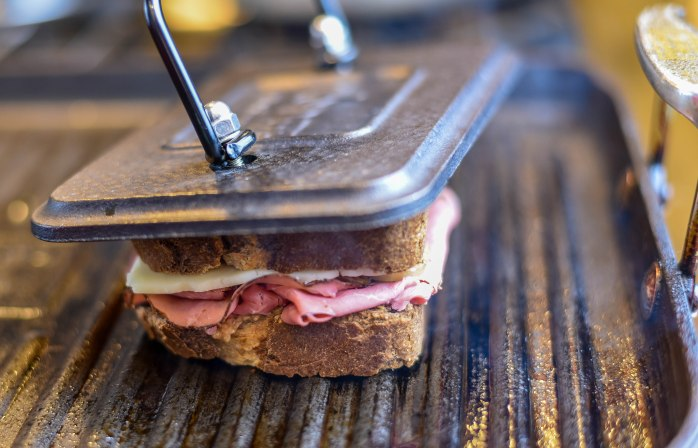 Grilled Pastrami and Cheese with Caramelized Onions and Caraway Whiskey Mustard.