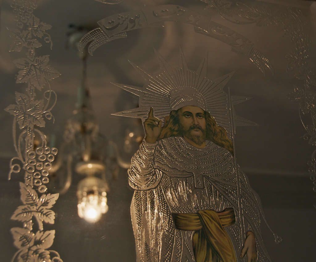 An image of Zoroaster appears on mirrored etched glass at the Zoroastrian Fire Temple in Taft, Iran (source - flickr)