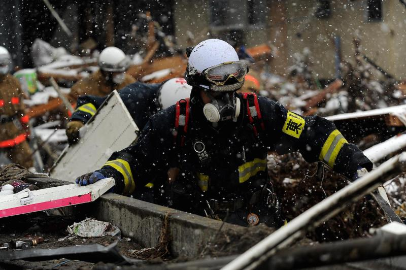A member with the Japanese Search and Rescue team searches through the damage and debris  on March 17, 2011, in Unosumai, Japan. A 9.0 earthquake hit Japan on March 11 that caused a tsunami that destroyed anything in its path.