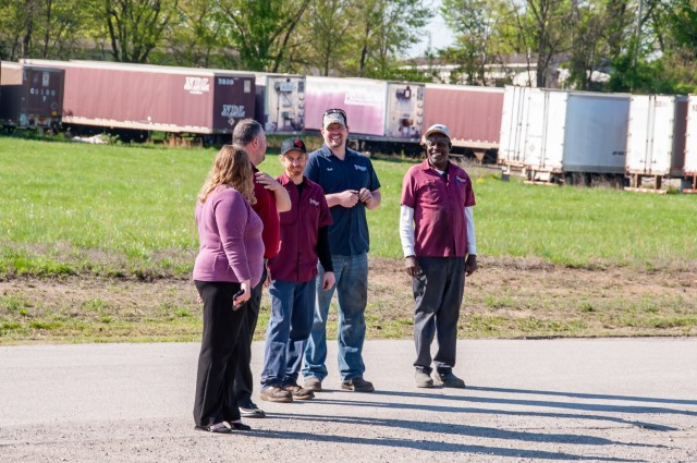 NDL employees chatting with one another outside