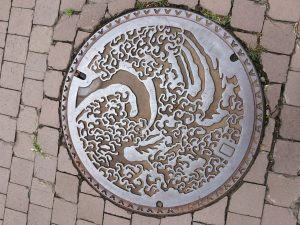 Manhole cover at Obuse