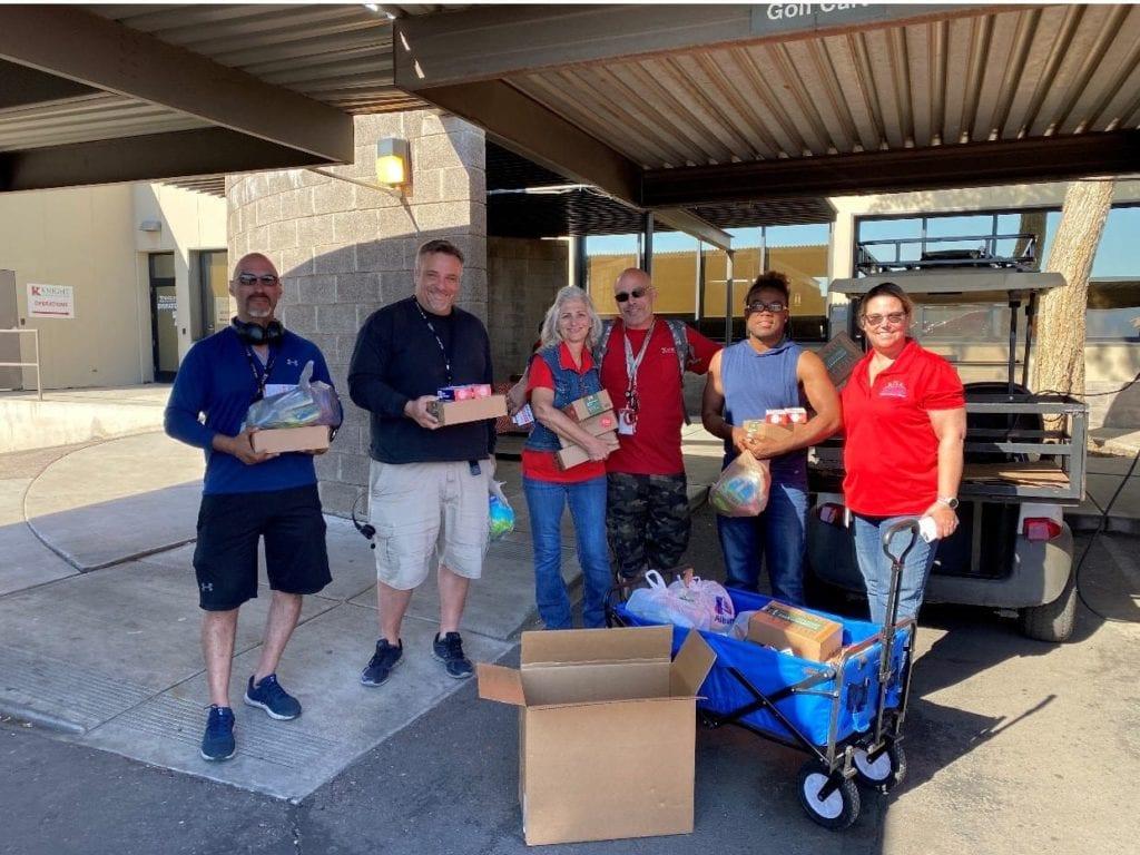 Volunteer at Buckeye, AZ terminal boxing food items for drivers